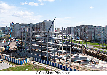 Construction site with cranes on sky background Kaliningrad...