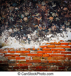 Old weathered brick wall and tradition thai painting on...