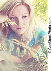 pensive woman - Young romantic pensive woman dreaming in...