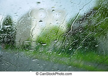 Raindrops on the window - Rain drops on window with blurry...