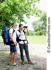two tourists - A group of young backpackers with map and...