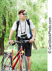 tourist with bicycle