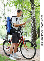 tourist with bicycle and map