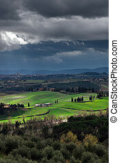 Stormy weather landscape with beautiful light, Tuscany,...