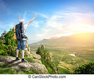 Tourist with in mountains - Tourist with backpack enjoy...