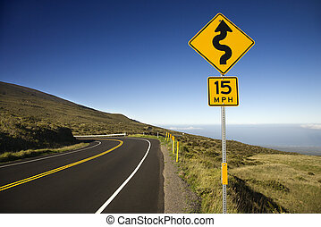Road in Maui, Hawaii - Curvy road sign in Haleakala National...