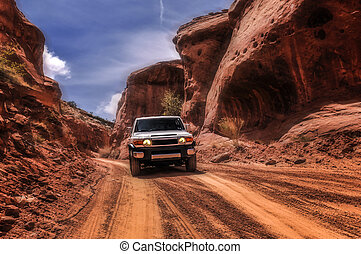 Off roading in Utah - Off road vehicle goind down the hill...
