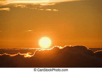 Sun rising over clouds - Aerial of sunrise in Haleakala...