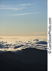 Above view of clouds at Haleakala - Aerial shot of dormant...