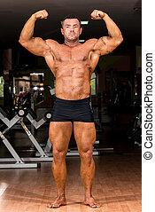 Muscular, corporal, construtor, mostrando, seu, frente,...