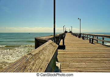 Beach Pier - Wooden pier at Holden's Beach in North Carolina