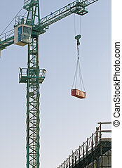 Crane lifting meterial in a construction site