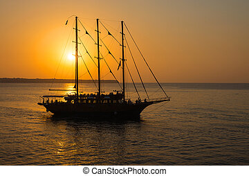 Romantic sunset with sailing ship