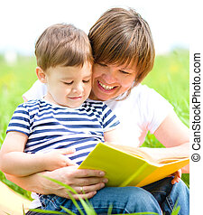 Mother is reading book for her child