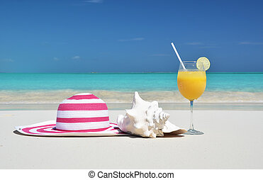 Hat and orange juice. Exuma, Bahamas