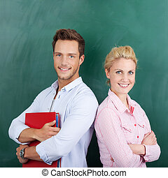 Portrait Of Students Against Green Background - Portrait of...