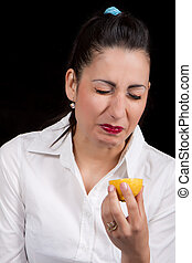 woman eat yellow lemon - Woman holding in hands yellow lemon...