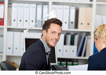 Smiling Businessman In Business Meeting