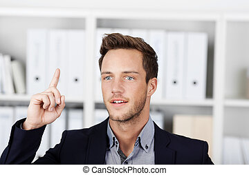 Businessman Pointing At Something - Closeup of a young male...