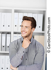 Happy Young Businessman In Office - Closeup portrait of a...