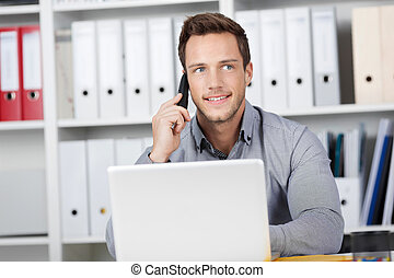 Smiling Young Businessman On Call - Young smiling...