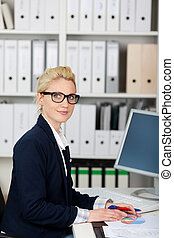 Serious Businesswoman At Work - Portrait of a serious and...