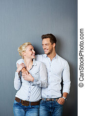 Loving Couple Against Blue Background - Portrait of a young...