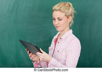 Blond Student Using Digital Tablet