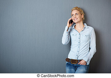 Smiling Blond Woman Using Phone - Happy young blond woman...