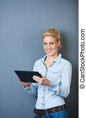 Smiling Woman Using Digital Tablet - Smiling young female...