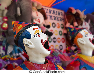 clowns at the funfair - sideshow clowns with big mouths at...