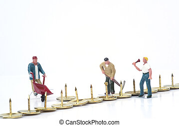 Miniature people teamwork overcoming obstacles business concept