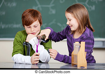 Teamwork in the chemistry class with a cute little girl...
