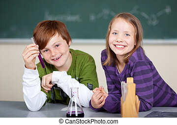 Smiling kids having fun in the chemistry class