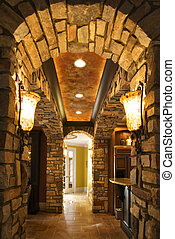 Arched hallway in house.