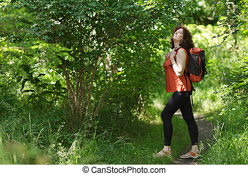 Backpacker in wild nature