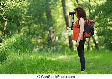 Woman observing wildlife