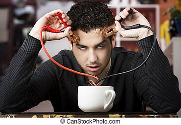 Coffee Jolt - Young man holding jumper cables coming out of...