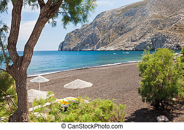 Kamari Beach Santorini - The black volcanic beach at Kamari...