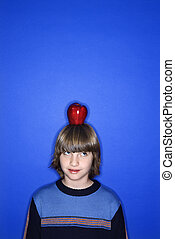 Boy with apple on head.