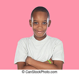 Smiling african adolescent with a happy gesture on a pink...