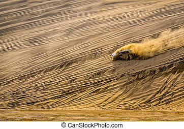 Off-road vehicle driving in the sand desert dunes