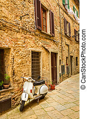 Vespa on a small street in the old town, Italy