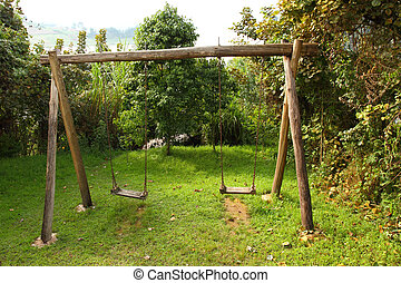 Rustic Wooden Swing Set - A rustic wooden swing set sitting...
