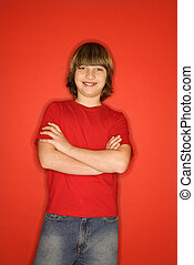 Boy smiling - Portrait of Caucasian boy in studio standing...