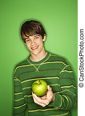 Boy holding apple.