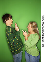 Teen boy and girl fighting - Portrait of Caucasian teen girl...