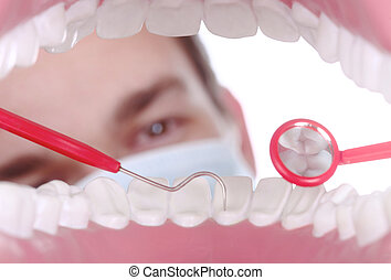 Caucasian Dentist Working Inside a Patient Mouth - Dentist...