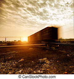 Freight train - Dusk, fast moving Freight train.