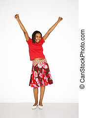 Girl with arms raised. - Portrait of African-American teen...